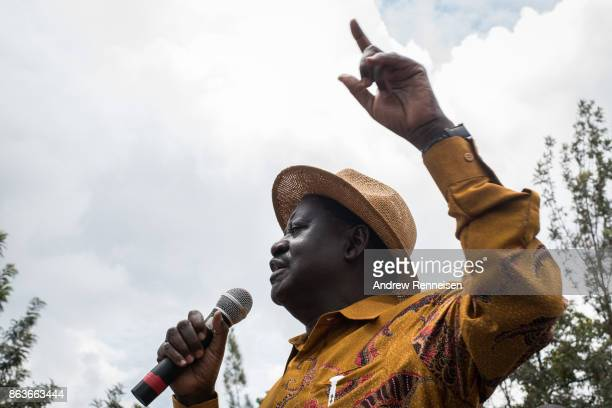 Opposition candidate Raila Odinga speaks to the crowd gathered at a funeral service for three men killed by the police during a protest the week...