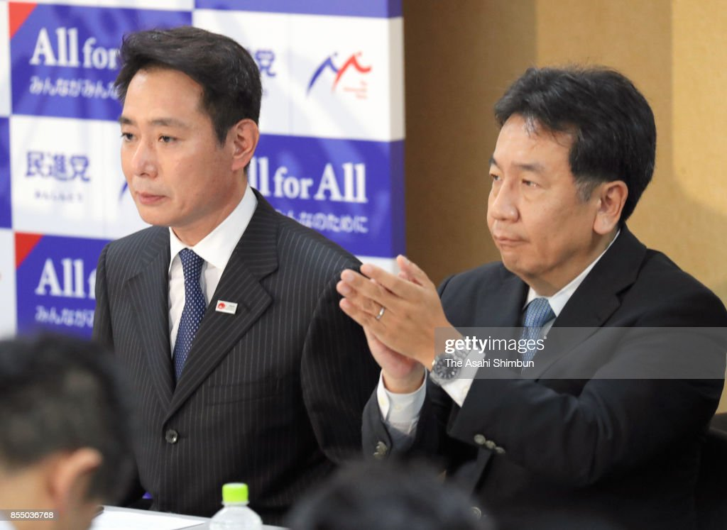 Opposition Democratic Party President Seiji Maehara (L) and Deputy President Yukio Edano (R) attend the party's lawmakers meeting at the party headquarters after the Lower House was dissolved on September 28, 2017 in Tokyo, Japan. Prime Minister Shinzo Abe dissolves the Lower House, the snap election will be held on October 22.