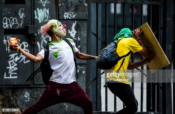 Opposition demonstrators clash with riot police during an antigovernment protest in Caracas on July 20 2017 A 24hour nationwide strike got underway...