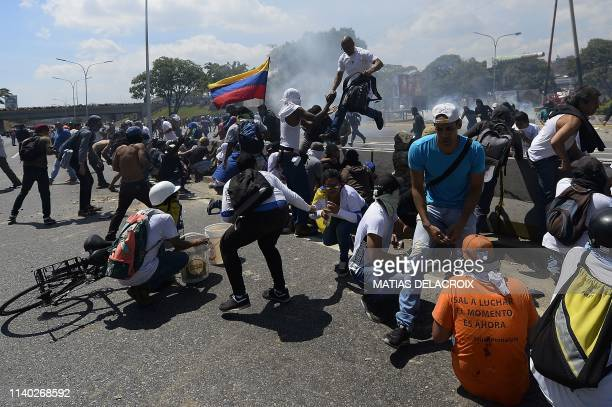 Opposition demonstrators clash with soldiers loyal to Venezuelan President Nicolas Maduro after troops joined opposition leader Juan Guaido in his...