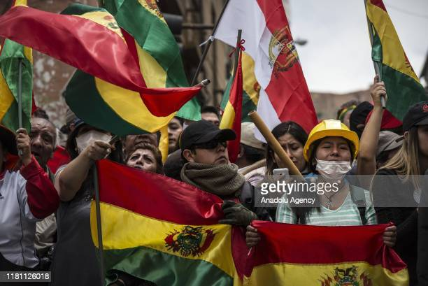 Opposition demonstrators protest in front of a police station in La Paz, Bolivia on November 9, 2019. National police declared mutinies joined...