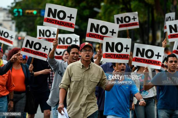 TOPSHOT Opposition demonstrators take part in protest against the government of President Nicolas Maduro called by opposition leader and...