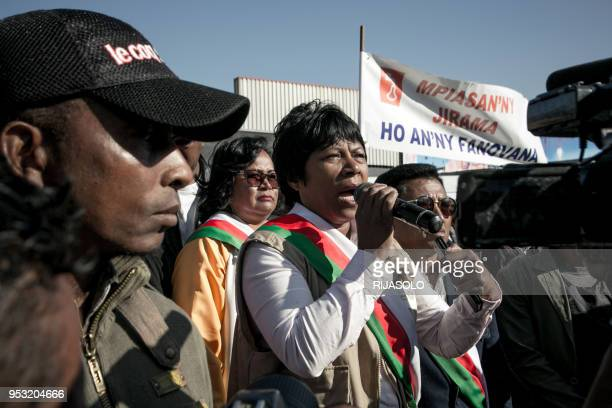 Opposition deputy Hanitra Razafimanantsoa speaks during an antigovernment demonstration in front of a plant of the public water and electricity...
