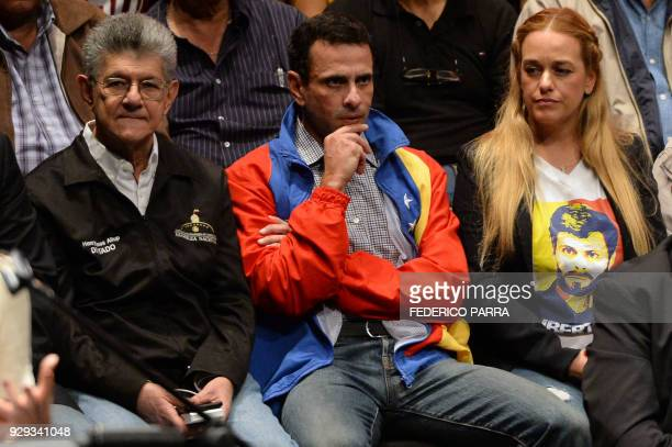 Opposition deputy Henry Ramos Allup opposition leader Henrique Capriles Radonski and Lilian Tintori wife of Venezuela's currently under house arrest...