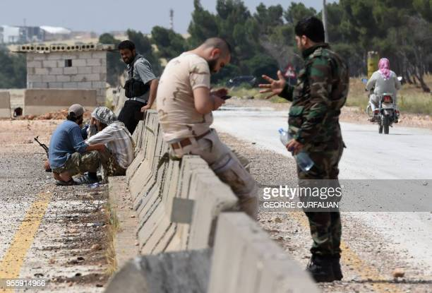 Opposition fighters and their family members evacuated from the towns of Yalda Babila and Beit Saham south of Syria's capital under a negotiated...