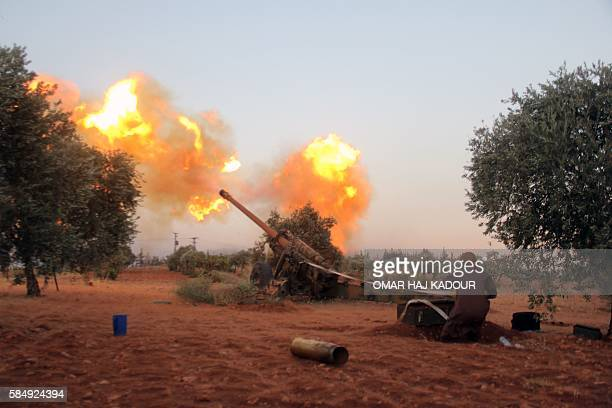 Opposition fighters belonging to Ajnad AlSham fire shells from their position in Aleppo's southern countryside towards regime positions on July 31 in...