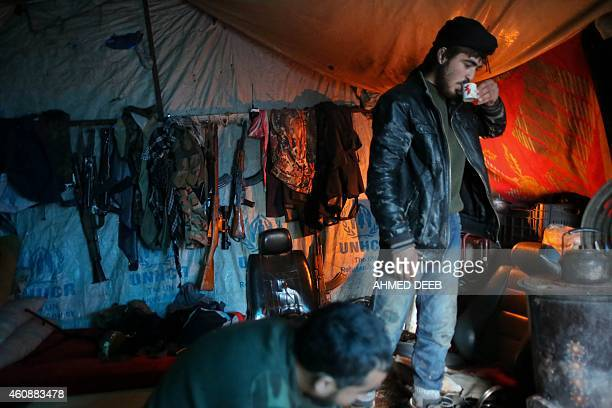 Opposition fighters from the Ahrar alSham group drink coffee inside a tent in a rebelheld area of the Handarat region located just north of the...
