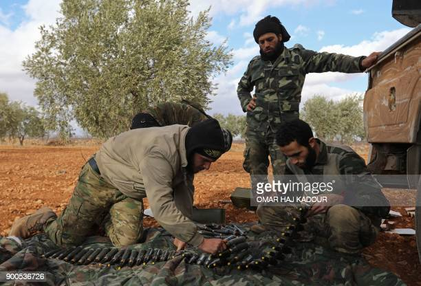 TOPSHOT Opposition fighters prepare ammunition in the alMushrifa area near the town of Khan Sheikun in Syria's northwestern rebelheld province of...