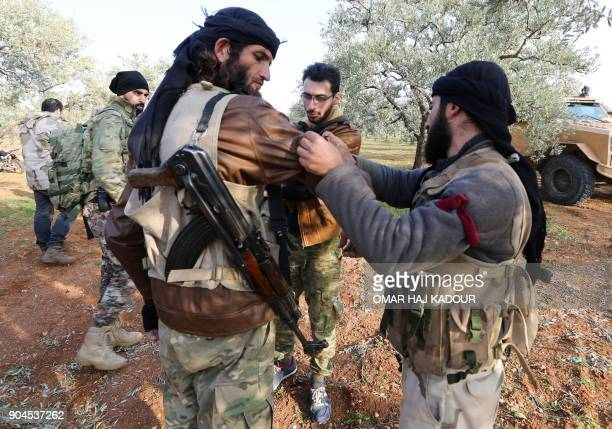 Opposition fighters prepare to head towards the frontline near the village of AlKhuwayn during ongoing battles with government forces in Syria's...