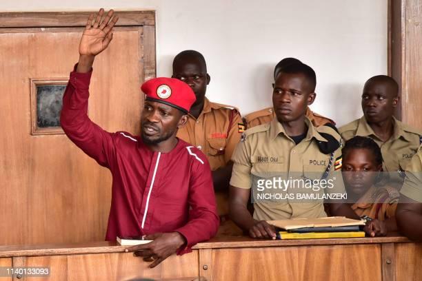 Opposition figurehead Hon Kagulanyi Robert aka Bobi Wine lifts his hand in the dock in the court room of Kampala court on April 29 2019 Ugandan...
