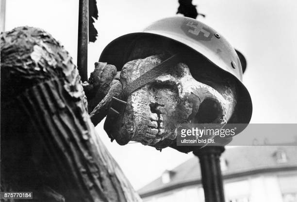 Opposition from outside the German parliament Demonstration in Frankfurt am Main against the German Emergency Acts skeleton wearing helmet with...
