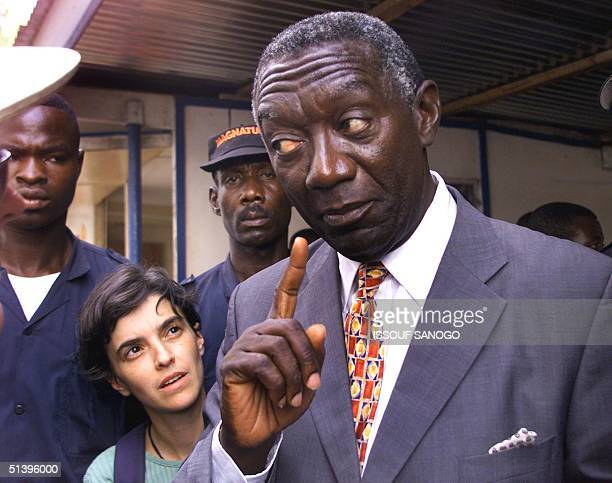 Opposition Ghanean presidential candidate John Kufuor of the New Patriotic Front answers a journatist 's questions in the courtyard of the Press...