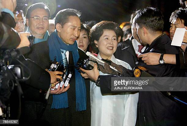 Opposition Grand National Party presidential candidate Lee MyungBak and his wife Kim YoonOk speak to the press after casting their ballots in the...