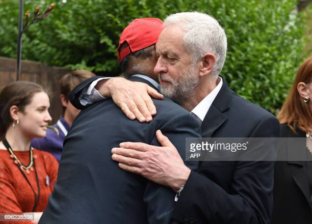 Opposition Labour party leader Jeremy Corbyn hugs councillor Mushtaq Lasharie as he arrives at St Clement's Church in west London who have provided...