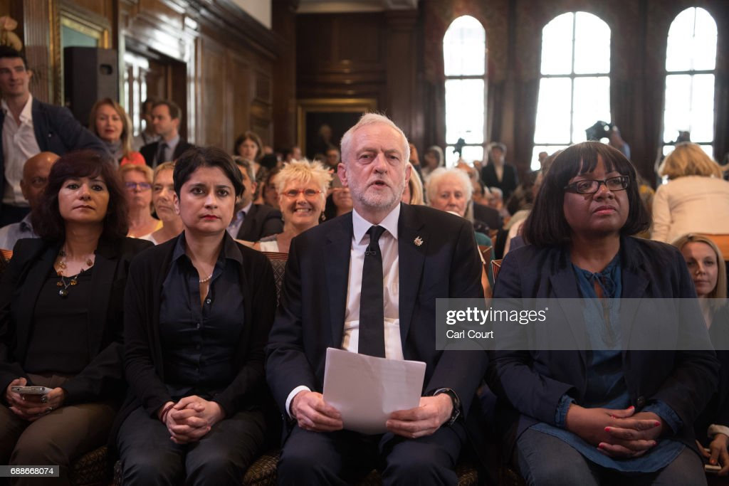 Opposition Labour Party leader Jeremy Corbyn (C-R) sits with his wife, Laura Alvarez (L); Shadow Attorney General for England and Wales, Shami Chakrabarti (C-L) and Shadow Home Secretary, Diane Abbott (R) as he arrives to make a speech on defence on May 26, 2017 in London, England. Mr Corbyn stated that UK foreign policy would change under a Labour government to one that 'reduces rather than increases the threat' to the country, as election campaigning resumed after the attack in Manchester earlier this week.