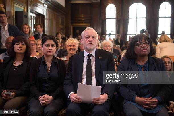 Opposition Labour Party leader Jeremy Corbyn sits with his wife Laura Alvarez Shadow Attorney General for England and Wales Shami Chakrabarti and...