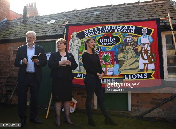 TOPSHOT Opposition Labour party leader Jeremy Corbyn waits with shadow foreign secretary Emily Thornberry in front of a Unite Union banner ahead of...