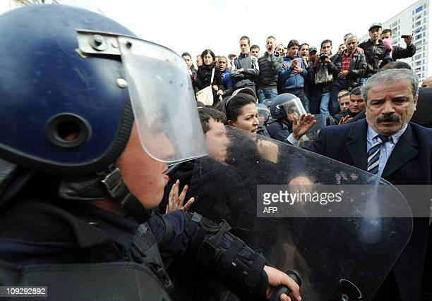 Opposition lawmaker Tahar Besbas of the Rally for Culture and Democracy party demonstrates with protestors in Algiers on February 19 2011 About 200...
