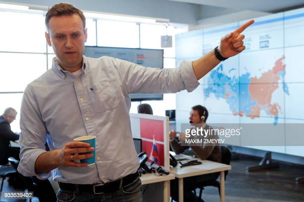 Opposition leader Alexei Navalny and his supporters election observers monitor the voting at the office of his Anticorruption Foundation in Moscow on...