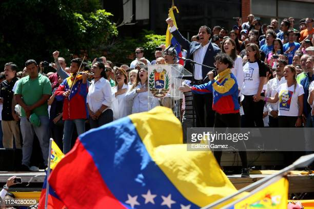 Opposition leader and self declared acting president of Venezuela Juan Guaido sings the national anthem during a demonstration at avenida Francisco...