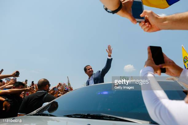 Opposition leader and Self proclaimed Interim President of Venezuela Juan Guaidó waves to supporters during a Citizens' Assembly on March 16, 2019 in...