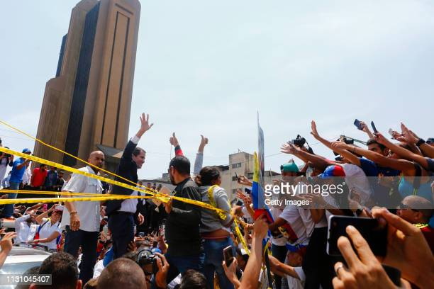 Opposition leader and Self proclaimed Interim President of Venezuela Juan Guaidó waves to supporters during a Citizens' Assembly on March 16 2019 in...