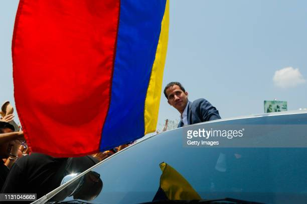 Opposition leader and Self proclaimed Interim President of Venezuela Juan Guaidó looks on from his car during a Citizens' Assembly on March 16, 2019...