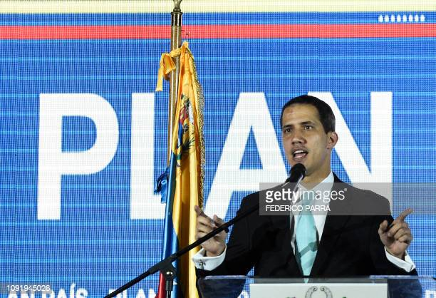 Opposition leader and selfproclaimed acting president Juan Guaido presents his government's plan at the auditorium of Venezuela's Central University...