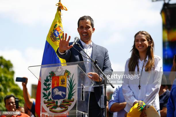Opposition leader and self-proclaimed interim president of Venezuela Juan Guaidó gestures, next to his wife Fabiana Rosales, as they arrive to a...