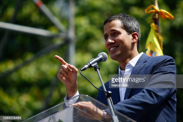Opposition leader and self-proclaimed interim president of Venezuela Juan Guaidó talks to supporters during a rally against the government of Nicolás...