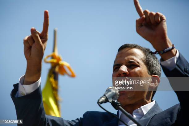 Opposition leader and selfproclaimed interim president of Venezuela Juan Guaidó talks to supporters during a rally against the government of Nicolás...