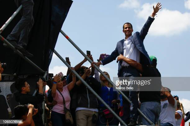 Opposition leader and selfproclaimed interim president of Venezuela Juan Guaidó waves after taking with supporters during a rally against the...