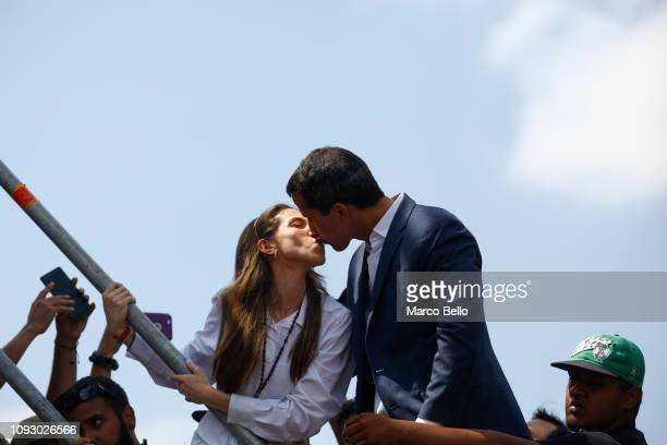 Opposition leader and selfproclaimed interim president of Venezuela Juan Guaidó kisses his wife Fabiana Rosales after taking with supporters during a...