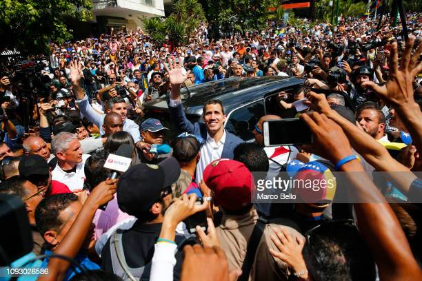 Opposition leader and selfproclaimed interim president of Venezuela Juan Guaidó waves as he leaves after taking with supporters during a rally...