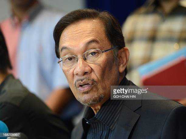 Opposition leader Anwar Ibrahim answers a question during a press conference at his party head office in Petaling Jaya on May 7 2013 Anwar called for...