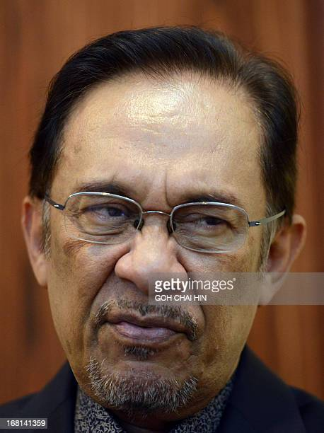Opposition leader Anwar Ibrahim reacts to a question during an interview at his party's head office in Petaling Jaya on May 6 2013 Anwar said his...
