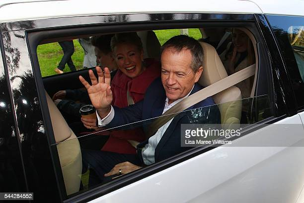 Opposition Leader Australian Labor Party Bill Shorten and wife Chloe Shorten wave from a car as they depart the Boathouse at Maribyrmong on July 3...