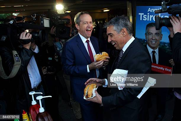 Opposition Leader Australian Labor Party Bill Shorten enjoys a sausage bread roll during a visit to a polling booth at Strathfield North Public...