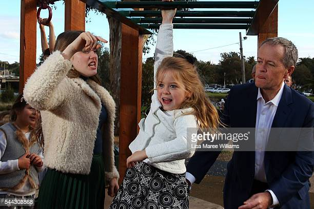 Opposition Leader Australian Labor Party Bill Shorten plays with daughter Clementine on the monkey bars as Georgette looks on at Maribyrmong on July...