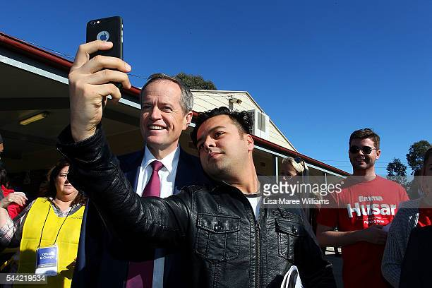 Opposition Leader Australian Labor Party Bill Shorten takes a photo with a supporter during a visit to a polling booth at Colyton on July 2 2016 in...