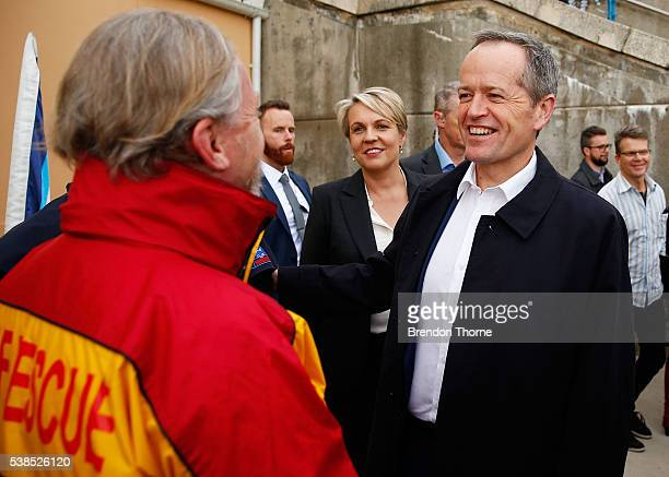 Opposition Leader Bill Shorten and Deputy Opposition Leader Tanya Plibersek shares a joke with Coogee Surf Lifesaving Club President Mark Doepel on...