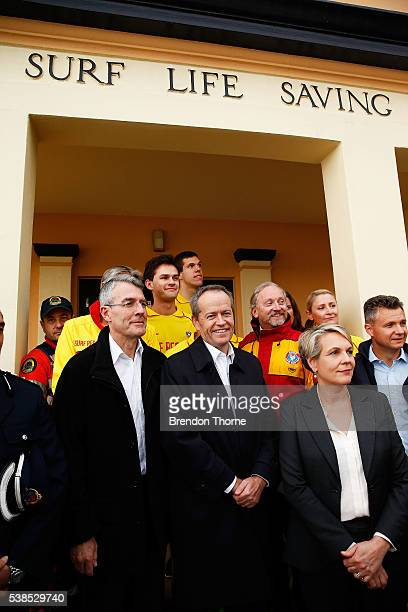 Opposition Leader Bill Shorten and Deputy Opposition Leader Tanya Plibersek pose for a photograph with Coogee Surf Lifesaving Club volunteers on June...