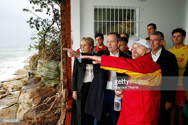 Opposition Leader Bill Shorten and Deputy Opposition Leader Tanya Plibersek look out of a gaping hole in the Coogee Surf Lifesaving Club on June 7...