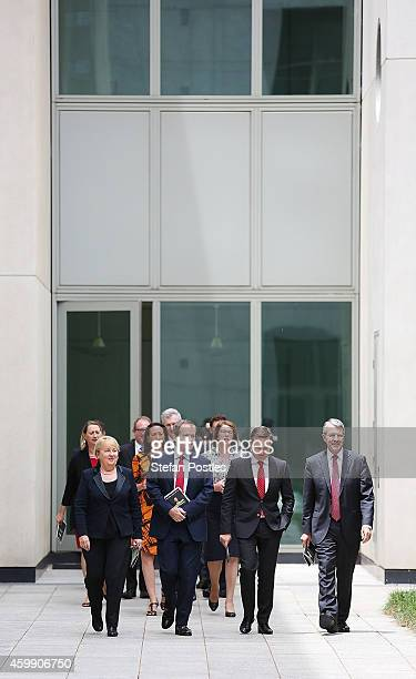 Opposition leader Bill Shorten and his colleagues arrive at a press conference to reflect on 'Tony Abbott's Year of Broken Promises' at Parliament...