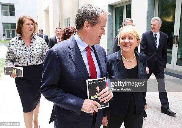 Opposition leader Bill Shorten and his colleagues leave a press conference to reflect on 'Tony Abbott's Year of Broken Promises' at Parliament House...