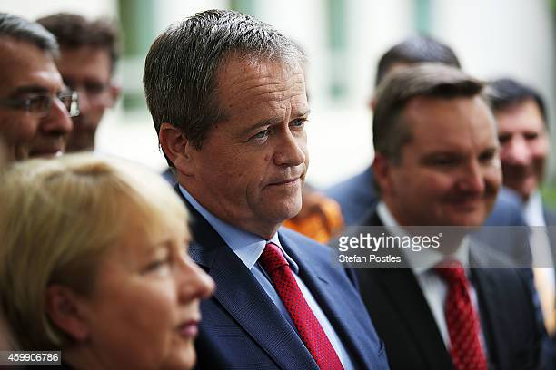Opposition leader Bill Shorten and his colleagues speak to the media during a press conference to reflect on 'Tony Abbott's Year of Broken Promises'...