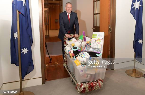 Opposition Leader Bill Shorten arrives with a trolly of presents for the Kmart Wishing Tree Salvation Army Present Collection at Parliament House on...
