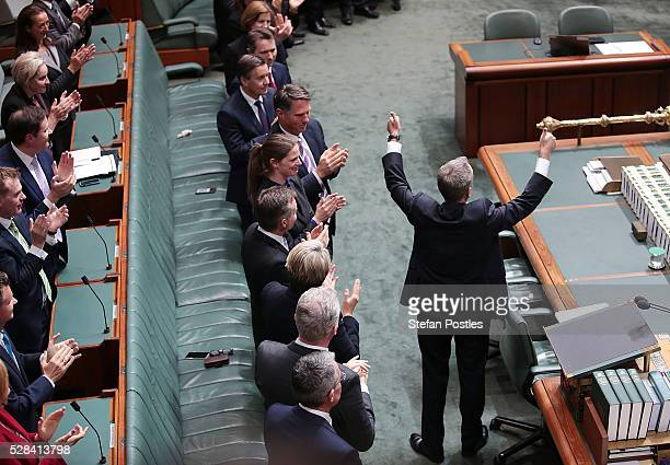 Opposition leader Bill Shorten gives the thumbs up to people in the house after delivering his budget reply speech on May 5 2016 in Canberra...