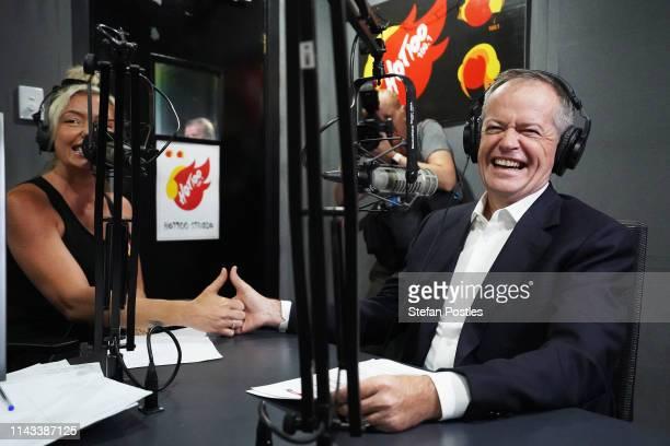 Opposition Leader Bill Shorten has a thumb war with Hot 100 fm radio host Dannii on April 18 2019 in Darwin Australia Mr Shorten today announced a...