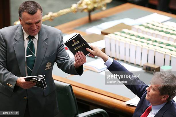 Opposition Leader Bill Shorten is forced to hand in his prop 'Tony Abbott's year of broken promises' during House of Representatives question time at...